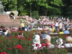 People listening to the outdoor concert.